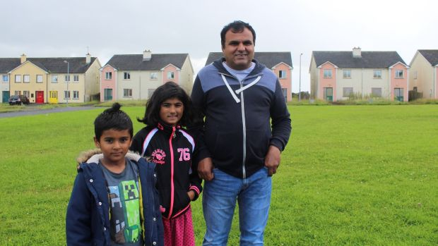 "Members of the Gul family, Almasyounus (father), Yousaf and Maryam, residents in Shannon Valley ""ghost estate"" outside Ballaghaderreen, Co Roscommon. Photograph: Simon Carswell"