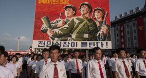 A propaganda poster is displayed during a rally in support of North Korea's stance against the US, on Kim Il-Sung square in Pyongyang on Wednesday. Photograph:   Kim Won-Jin/AFP/Getty Images
