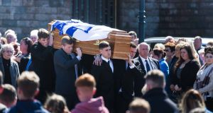 Mourners carry the coffin from St Senan's Church at the funeral of Karl Haugh in Kilkee, Co Clare on Wednesday.