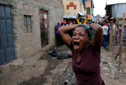 ELECTION PROTEST: A woman gestures as she mourns the death of a protester in Mathare, in Nairobi, Kenya. Photograph: Thomas Mukoya/Reuters