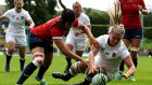 Defending champions England open with routine Spain win