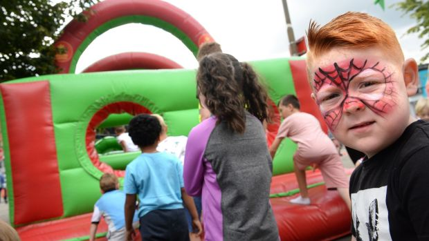 Logan Grimes queues for the bouncy castle at Hope Fest. Photograph: Dara Mac Dónaill