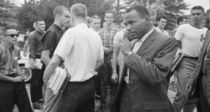 African American student James Meredith walks across the University of Mississippi campus after class amid the stares and jeers of fellow students back in 1962. Photograph: Getty Images