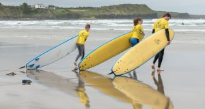 Surfers from  Fin McCool Surf School at Rossnowlagh. The school caters for all skill levels, from first-timers to experienced surfers.