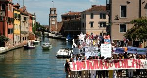 "Residents of Venice hold a banner saying ""My future is Venice"" during a protest against mass tourism  in the Italian city on July 2nd. Photograph:  Manuel Silvestri/Reuters"