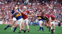 Tony Keady (white helmet) and Ollie Kilkenny put pressure on Tipperary's Pat Fox during the 1987 All-Ireland hurling semi-final. Photograph: Billy Stickland/Inpho