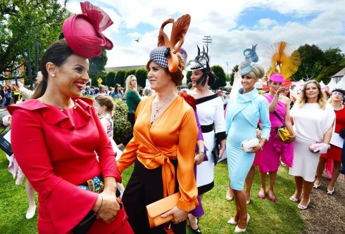 Alana Faron (Camlough, South Armagh), Cathy Dillon (Athenry), Suzanne Bushe (Athlone), Caithriona King (Galway), Eva Hayes Morrissey (Ahane, Co Limerick), Gemma Cosgrave (Harolds Cross), Linda Malone (Athboy) and Georgina Kane (Dublin) enter the best dressed competition on Ladies Day at the Dublin Horse Show. Photograph: Alan Betson/The Irish Times