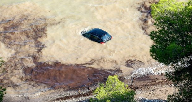 A car  trapped due to a flood at Sant Josep in Ibiza, Spain on August 10th. Dozens of people have been evacuated by sea after they got trapped in their houses due to floods caused by heavy rain. Photograph: Sergio G. Canizares/EPA