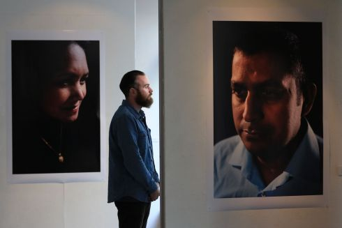 UNDOCUMENTED MIGRANTS: Photographer Liam Murphy with some portraits he shot of undocumented migrants who are living long-term in Ireland. The images are in a photographic exhibition at Dublin's Filmbase, Ireland: Can You See Me Now? Photograph: Nick Bradshaw