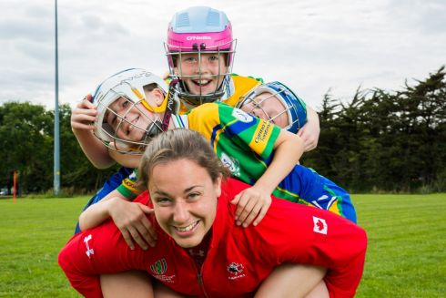 WOMEN'S RUGBY WORLD CUP: Canadian women's rugby players learn about camogie from under-11 girls at Clanna Gael Fontenoy GAA club in Ringsend, Dublin. From left are Canadian player Carolyn McEwen with Caterine Crowley, Grace Dolly and Ella May Spain of Clanna Gael Fontenoy. Photograph: Keith Arkins Media
