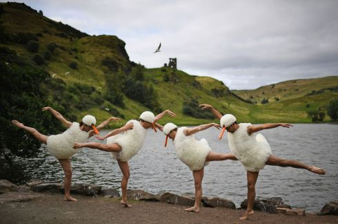 TUTU SPOOF: Performers from the show Tutu: Dance in All Its Glory perform at St Margaret's Loch in spoof Swan Lake costumes ahead of their Edinburgh Festival Fringe run in Scotland. Photograph: Jeff J Mitchell/Getty Images