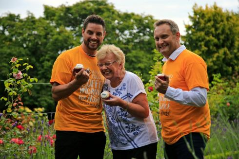 BIGGEST COFFEE MORNING: Keith Duffy and Mario Rosenstock with patient Nancy Freeman, of Palmerstown, in the rose garden at Our Lady's Hospice, Harold's Cross, Dublin, to help launch Ireland's Biggest Coffee Morning in aid of the facility. Photograph Nick Bradshaw