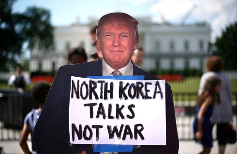 CARDBOARD TRUMP: A cardboard cut-out of US president Donald Trump during a Washington, DC protest against escalating threats of military action against North Korea. Photograph: Win McNamee/Getty Images