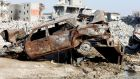 Remains of a car and buildings are seen following a security campaign against Shi'ite Muslim gunmen in the town of Awamiya, in the eastern part of Saudi Arabia. Photograph: Faisal Al Nasser/Reuters