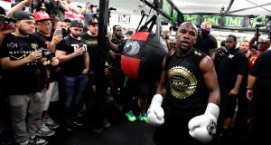 Floyd Mayweather believes his fight with Conor McGregor in Las Vegas won't go the distance. Photograph: John Gurzinski/AFP