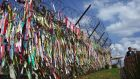 Ribbons with inscriptions calling for peace and reunification are displayed on a military fence at Imjingak peace park near the Demilitarized Zone (DMZ) dividing the two Koreas in the border city of Paju. Photograph: Jung Yeon-Je/AFP/Getty Images