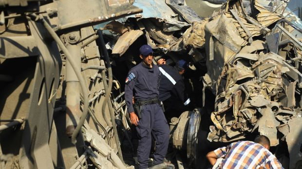 Egyptian security personnel examine wreckage after two passenger trains collided in Alexandria Egypt