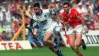 Waterford's Dan Shanahan is chased by Séan Óg Ó gAilpín during the National Hurling League final of 1998. Photograph: Patrick Bolger/Inpho