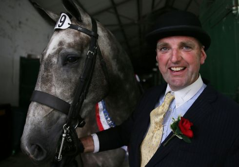 HORSE SHOW: John Roche and his horse Saggart Lord Lancer after winning the Pembroke Cup at the Dublin Horse Show in the RDS. Photograph: Brian Lawless/PA Wire
