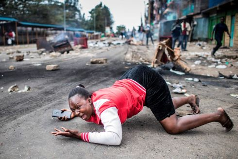 KENYAN ELECTION: A woman reacts to Kenyan police troops during a protest by supporters of the National Super Alliance's presidential candidate, in Nairobi. Photograph: Luis Tato/AFP/Getty Images