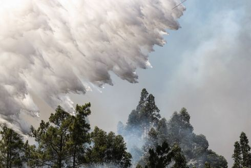 FOREST FIRE: Water is dropped from an aircraft on a forest fire at Bracal, Abrantes, Portugal. Photograph: Paulo Cunha/EPA