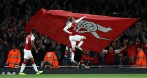 Arsenal's Aaron Ramsey celebrates scoring their third goal Photograph; Eddie Keogh/Reuters