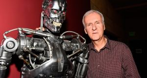 Machine man: James Cameron and a Terminator. Photograph:  Frazer Harrison/Getty Images