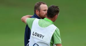 Shane Lowry of Ireland is consoled by his caddie Dermot Byrne after the second round of the 2017 PGA Championship at Quail Hollow Club in Charlotte, North Carolina. Photo: Warren Little/Getty Images