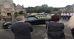 The funeral cortège of Kevin 'Flat Cap' Murray makes its way to Strabane cemetery. Photograph: Gerry Moriarty/The Irish Times