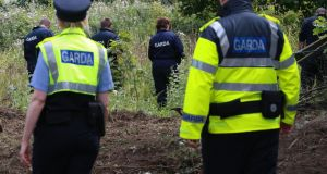 Trevor Deely investigation: Members of An Garda Siochana search a site in Chapelizod. Photograph: Nick Bradshaw