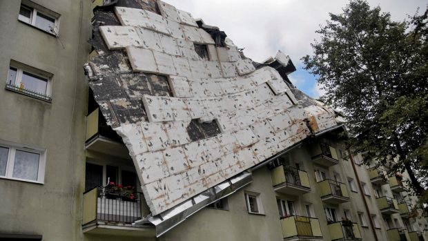 A roof destroyed by a storm hangs from an apartment building in Bydgoszcz, Poland on Saturday. Photograph: Grazyna Marks/Reuters