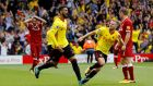 Miguel Britos celebrates scoring Watford's equaliser against Liverpool. Photograph: Darren Staples/Reuters