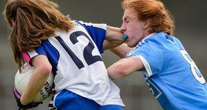 Dublin's Lauren Magee receives an elbow from Katie Murray of Waterford. Photo: Tom Beary/Inpho