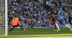 Manchester City's Sergio Aguero scores their first goal. Photograph: Hannah McKay/Reuters