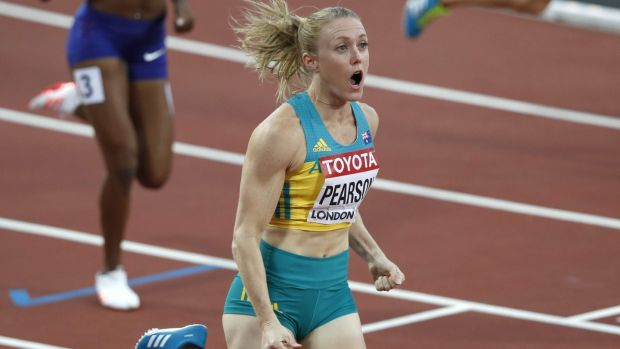 Australia's Sally Pearson celebrates winning the final of the women's 100m hurdles. Photo: Adrian Dennis/Getty Images