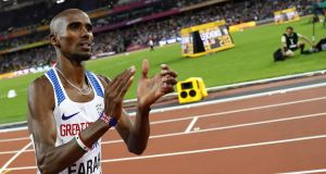 Mo Farah applauds the crowd after the race. Photo: Kai Pfaffenbach/Reuters