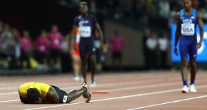 Usain Bolt of Jamaica falls to the track in the Men's 4x100 Relay final. Photo: Michael Steele/Getty Images