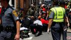 Rescue workers assist people who were injured when a car drove through a group of counter-protesters in Charlottesville, Virginia, US. Photograph: Joshua Roberts/Reuters