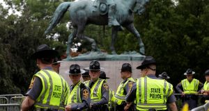 Virginia state troopers stand under a statue of Robert E Lee before a white supremacist rally in Charlottesville, Virginia, US. Photograph: Joshua Roberts/Reuters