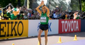 Rob Heffernan crosses the finish line in eighth place in London. Photograph: Morgan Treacy/Inpho