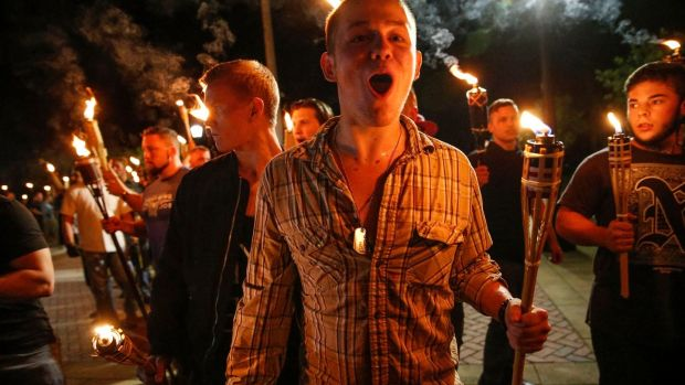 White nationalist groups march with torches through the UVA campus in Charlottesville on Friday. Photograph: Mykal McEldowney/The Indianapolis Star via AP