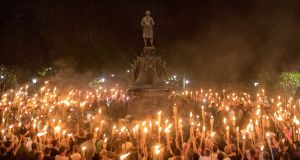 Torch-bearing white nationalists rally around a statue of Robert E Lee, the Confederate general, near the University of Virginia campus in Charlottesville. Photograph: Edu Bayer/The New York Times