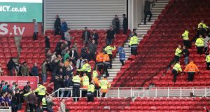 Fans clash in the stands during the  Championship match between Middlesbrough and Sheffield United  at the Riverside Stadium. Photograph:  Owen Humphreys/PA Wire