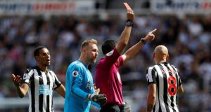 Referee Andre Marriner shows Newcastle United's Jonjo Shelvey a red card for a stamp on Tottenham's Dele Alli. Photograph: Lee Smith/Action Images via Reuters