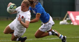 England's Lydia Thompson  breaks clear from Michela Sillari of Italy to score a try during the Women's Rugby World Cup match at Belfield. Photograph:  David Rogers/Getty Images