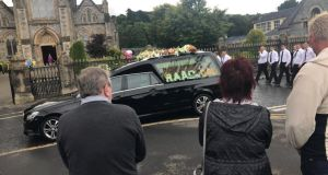 The funeral cortège of Kevin 'Flat Cap' Murray makes its way to Strabane cemetery. Photograph: Gerry Moriarty