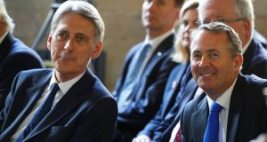 The British chancellor Philip Hammond, left, and the international trade secretary Liam Fox have jointly stated that Brexit would mean the UK pulling out of both the EU single market and the customs union. Photograph: Phil Noble/Reuters