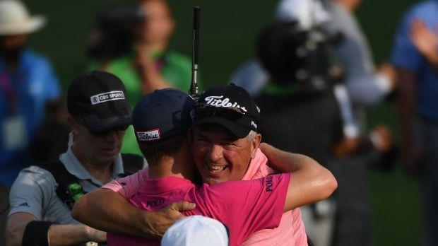 Thomas embraces his father Mike after the final round. Photo: Ross Kinnaird/Getty Images