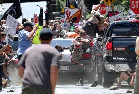 People fly into the air as a vehicle drives into a group of protesters demonstrating against a white nationalist rally in Charlottesville, on., Saturday, Aug. 12, 2017. The nationalists were holding the rally to protest plans by the city of Charlottesville to remove a statue of Confederate Gen. Robert E. Lee. Photo: Ryan M. Kelly/The Daily Progress via AP