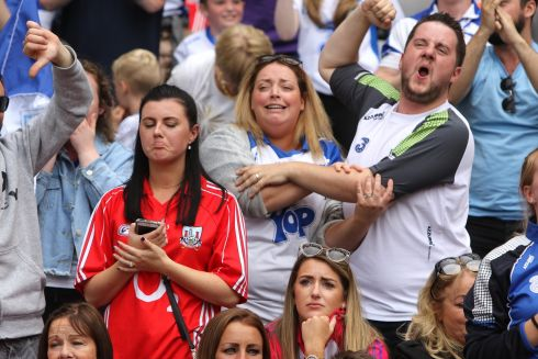 CONTRASTING EMOTIONS: Waterford and Cork fans watch the Déise pull away in the final minutes of their All-Ireland semi-final clash at Croke Park. Photograph: Tom Honan